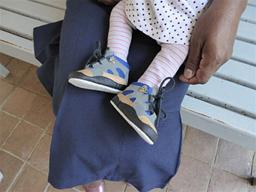 2014 - little girl with new shoes at Open Arms Displays a larger version of this image in a new browser window