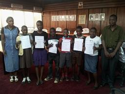 School kids with their certificates Displays a larger version of this image in a new browser window