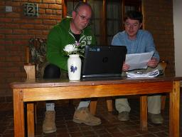 Typing up report at Dedza Pottery Displays a larger version of this image in a new browser window